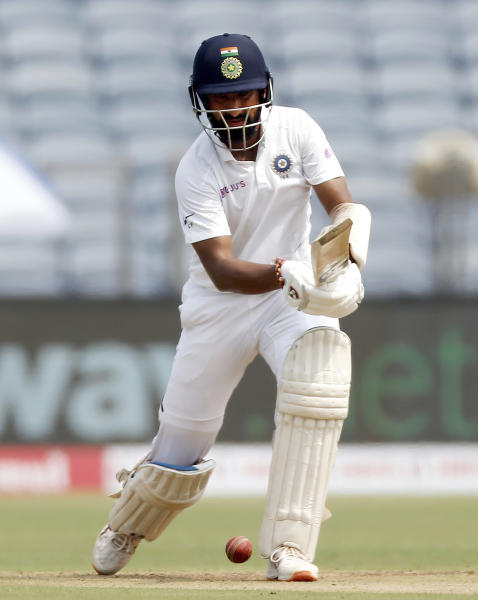 India's Cheteshwar Pujara plays a shot during the second cricket test match between India and South Africa in Pune, India, Thursday, Oct. 10, 2019. (AP Photo/Rajanish Kakade)