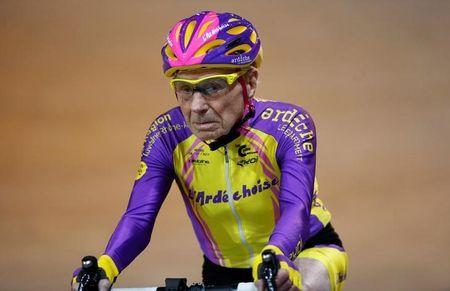 FILE PHOTO: French cyclist Robert Marchand, aged 105, rides on his way to cover 22.528 km (14.08 miles) in one hour to set a new record at the indoor Velodrome National in Montigny-les-Bretonneux, southwest of Paris, France, January 4, 2017. REUTERS/Jacky Naegelen