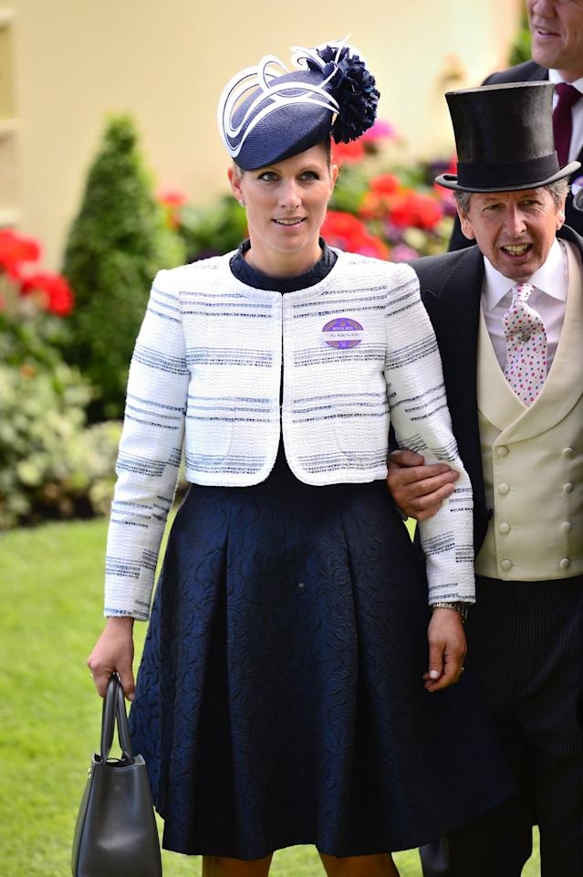 <p>The royal turned up to the 2015 racecourse in a patterned navy dress and chic cream jacket.<br /><i>[Photo: PA]</i> </p>