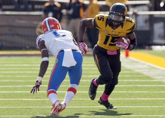 FILE - In this Oct. 19, 2013, file photo, Missouri wide receiver Dorial Green-Beckham runs as Florida Gators defensive back Marcus Roberson defends during the fourth quarter of an NCAA college football game in Columbia, Mo. Green-Beckham has been suspended indefinitely for an unspecified violation of team rules, three months after he and two friends were arrested on suspicion of felony drug distribution. Coach Gary Pinkel announced the suspension Monday, April 7, 2014, in a brief news release. (AP Photo/L.G. Patterson, File)