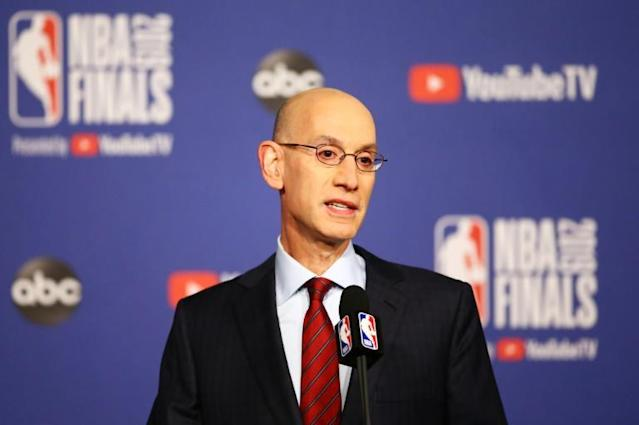NBA commissioner Adam Silver reportedly will wait another two to four weeks before making any decision about whether or not the league returns from its coronavirus hiatus (AFP Photo/Vaughn Ridley)