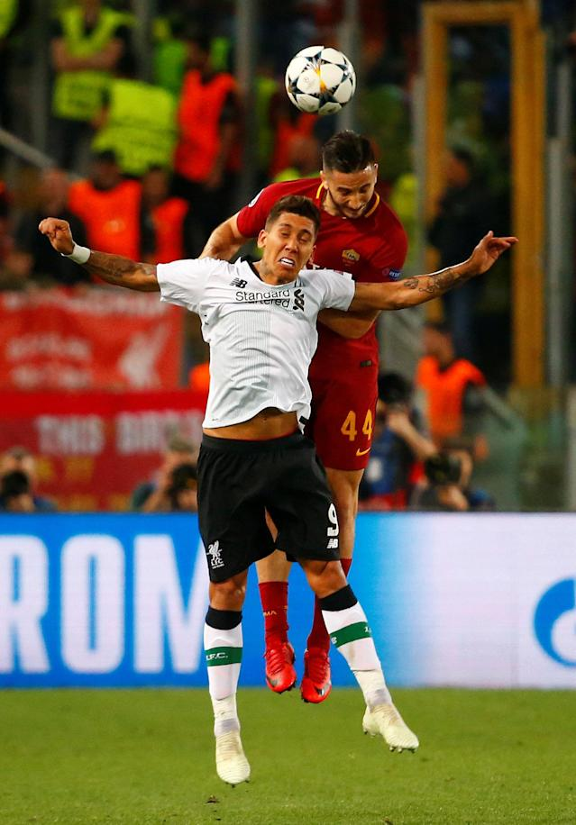 Soccer Football - Champions League Semi Final Second Leg - AS Roma v Liverpool - Stadio Olimpico, Rome, Italy - May 2, 2018 Liverpool's Roberto Firmino in action with Roma's Konstantinos Manolas REUTERS/Tony Gentile