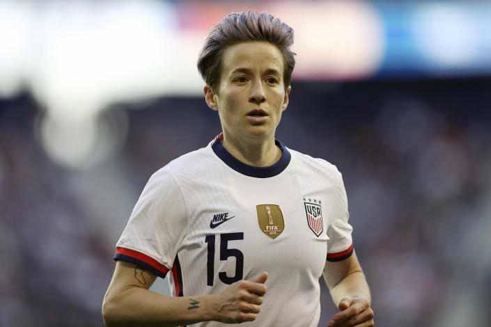 FILE - In this March 8, 2020, file photo, United States forward Megan Rapinoe (15) runs over to take a corner kick during the second half of a SheBelieves Cup soccer match against Spain, in Harrison, N.J. U.S. national team players Megan Rapinoe, Tobin Heath and Christen Press have opted out of the National Women's Soccer League tournament kicking off this weekend in Utah.  (AP Photo/Steve Luciano, File)
