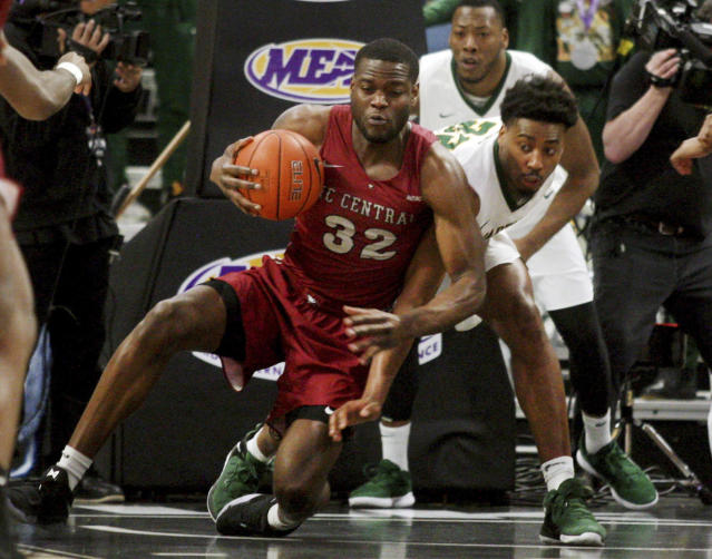 North Carolina Central's Raasean Davis, left, and Norfolk State's Alex Long fight for possession during an NCAA college basketball game in the championship of the Mid-Eastern Athletic Conference tournament, Saturday, March 16, 2019, in Norfolk, Va. (AP Photo/Jason Hirschfeld)