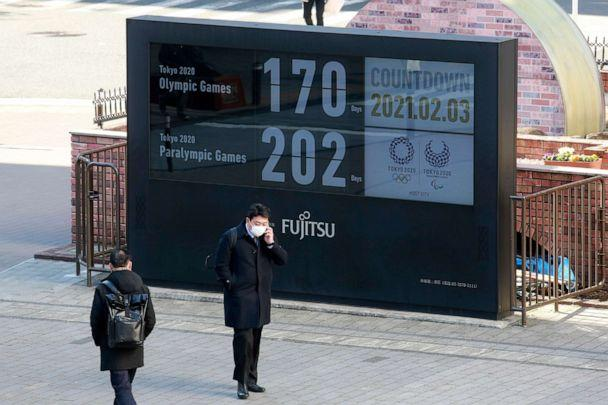 PHOTO: A man stands in front of a countdown clock for Tokyo Olympic and Paralympic Games in Tokyo, Japan, on Feb. 3, 2021. (Koji Sasahara/AP)