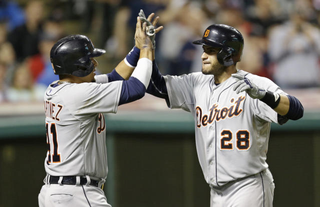 Detroit Tigers' J.D. Martinez, right, is congratulated by Victor Martinez after hitting a three-run home run off Cleveland Indians relief pitcher John Axford in the eighth inning of a baseball game on Friday, June 20, 2014, in Cleveland. Victor Martinez and Miguel Cabrera also scored on the hit. (AP Photo/Tony Dejak)