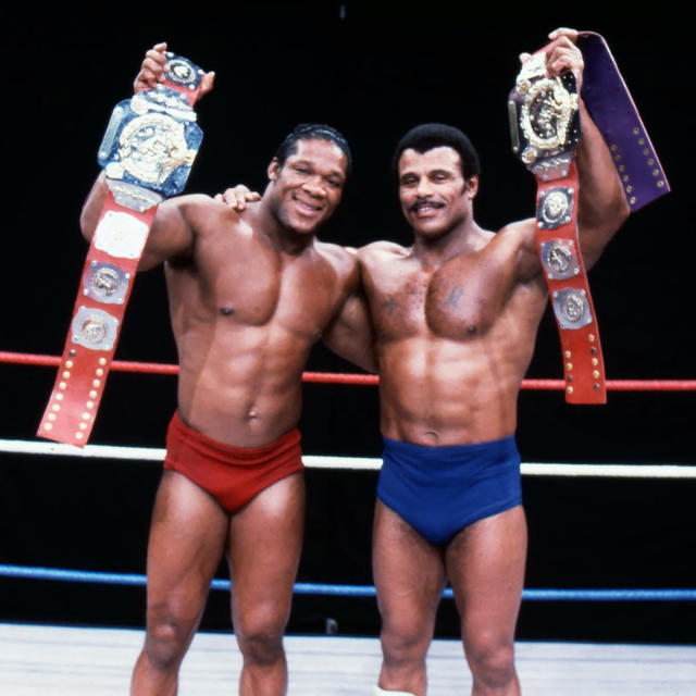"In this undated photo provided by WWE, Inc., Tony Atlas, left, and Rocky ""Soul Man"" Johnson pose in the ring with their championship wrestling belts. Johnson, a WWE Hall of Fame wrestler who became better known as the father of actor Dwayne ""The Rock"" Johnson, died Wednesday, Jan. 15, 2020. He was 75. (WWE, Inc. via AP)"
