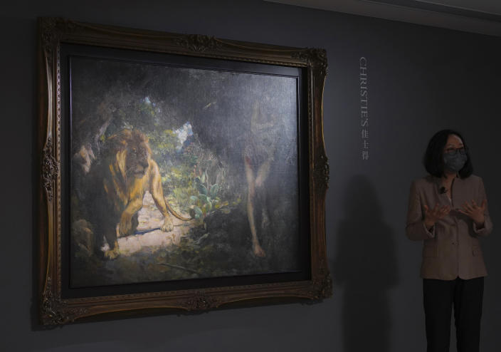 """A printing by Chinese modern artist Xu Beihong, titled """"Slave and Lion."""" Is displayed during a Christie's auction preview in Hong Kong, Monday, April 19, 2021. The painting by Xu from 1924 is expected to fetch at least $45 million in an auction in Hong Kong, as the appetite for art continues to rise among collectors even amid global economic uncertainty brought about by the coronavirus pandemic. (AP Photo/Vincent Yu)"""