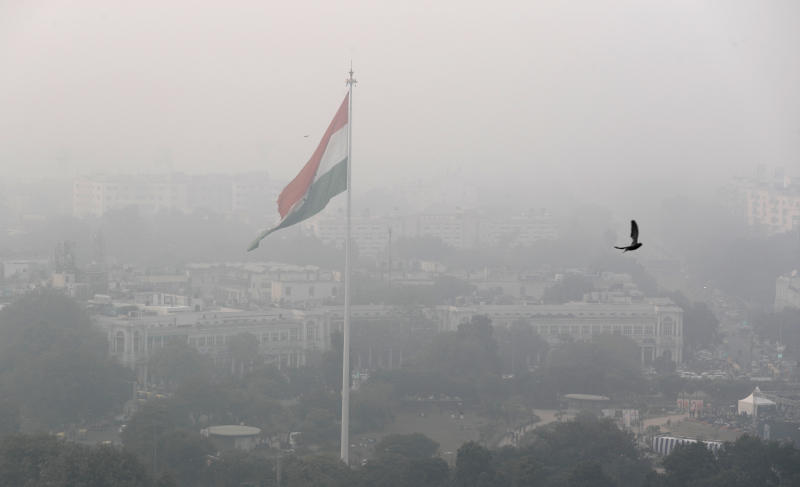 A bird flies past as Delhi's sky line is seen enveloped in smog and dust in New Delhi, India, Nov. 1, 2019. (Photo: Manish Swarup/AP)