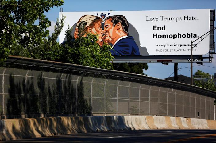 <p>A billboard installed in advance of the Republican National Convention depicts Republican presidential candidate Donald Trump kissing former presidential candidate Sen. Ted Cruz in Cleveland, Ohio, July 15, 2016. (Photo: Aaron P. Bernstein/Reuters)</p>