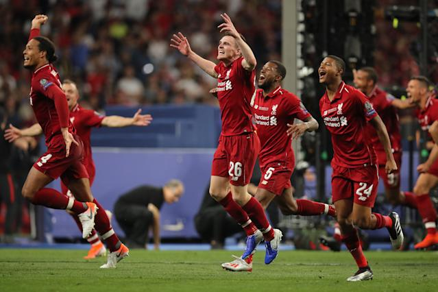 Andrew Robertson of Liverpool and teammates celebrate after winning the Champions League final (Photo by Matthew Ashton - AMA/Getty Images)