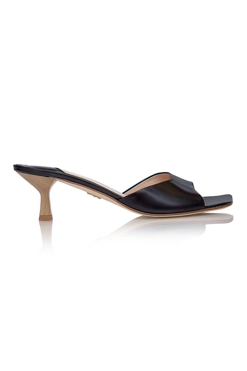 <p>These <span>Brother Vellies Midnight Tuesday Mules</span> ($455) are versatile, but the wood heel adds a little something extra.</p>