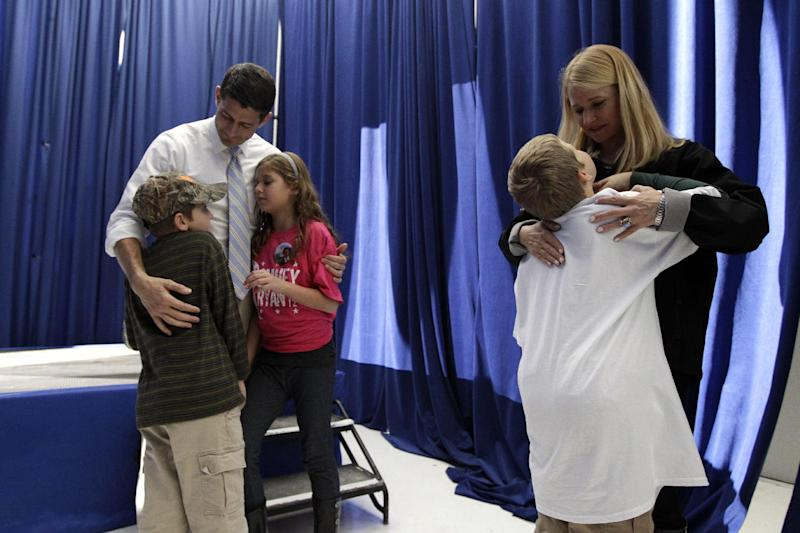 Republican vice presidential candidate, Rep. Paul Ryan, R-Wis., and his wife Janna talk to their children, from left, Sam, Liza and Charlie backstage before a campaign event, Sunday, Nov. 4, 2012, in Mansfield, Ohio.  (AP Photo/Mary Altaffer)