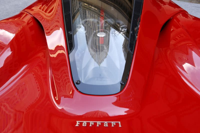 FILE PHOTO: A Ferrari sports car sits outside the New York Stock Exchange in New York ahead of Ferrari IPO