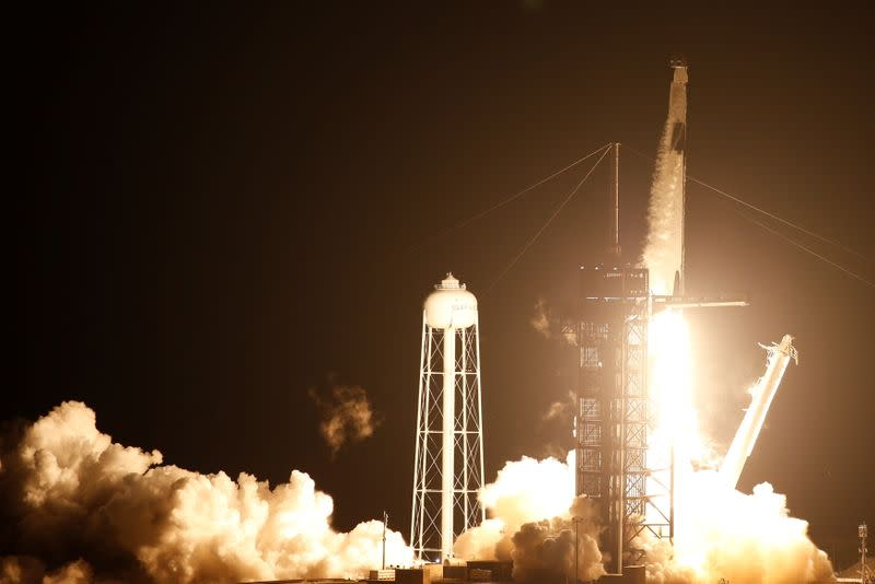 A SpaceX Falcon 9 rocket, topped with the Crew Dragon capsule, is launched carrying four astronauts on the first operational NASA commercial crew mission at Kennedy Space Center in Cape Canaveral