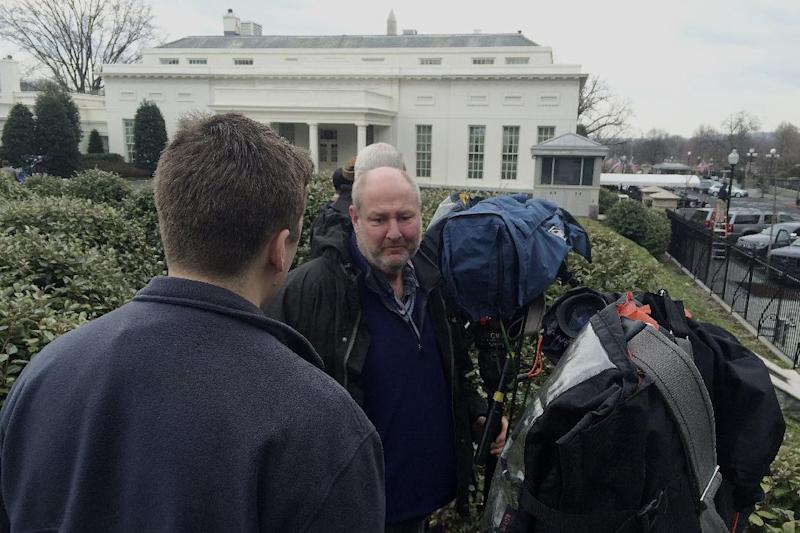 Television news cameramen point their cameras to the West Wing entrance of the White House in Washington, Friday, Feb. 21, 2014, hoping to catch Tibetan spiritual leader the Dalai Lama arriving for a closed press meeting with President Barack Obama. (AP Photo/Charles Dharapak)