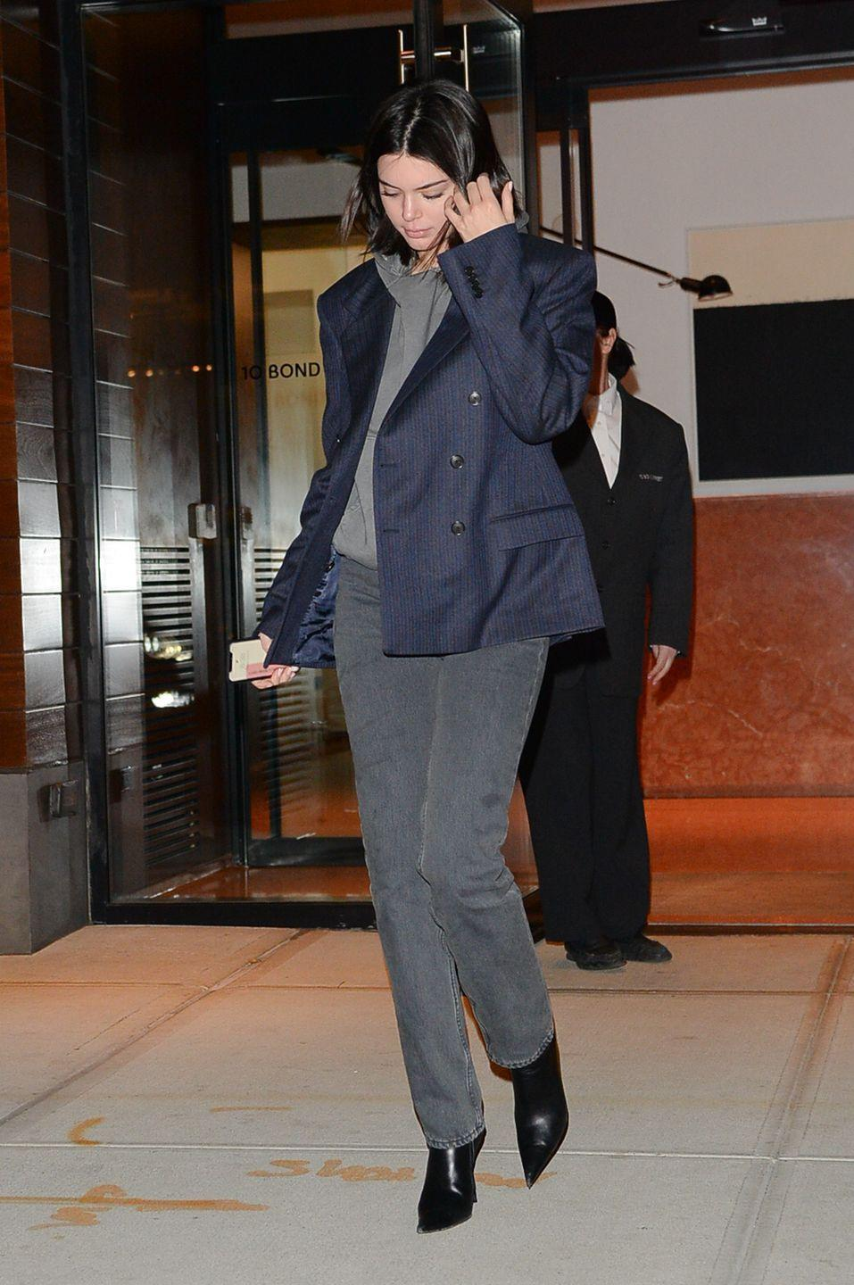 <p>The model wore grey suit trousers, a grey hoodie and a navy blue blazer, January 2018</p>