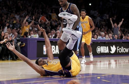 Los Angeles Lakers' Andrew Bynum celebrates a basket against the Denver Nuggets during the first half of a NBA first-round playoff basketball game in Los Angeles, Tuesday, May 1, 2012. (AP Photo/Chris Carlson)