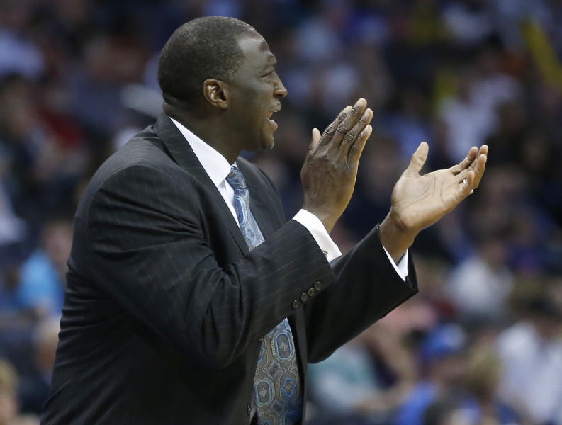 Utah Jazz head coach Tyrone Corbin shouts to his team during the second quarter of a preseason NBA basketball game against the Oklahoma City Thunder in Oklahoma City, Sunday, Oct. 20, 2013. (AP Photo/Sue Ogrocki)