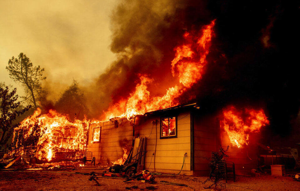 Flames consume a house near Old Oregon Trail as the Fawn Fire burns about 10 miles north of Redding in Shasta County, California on September 23, 2021. / Credit: Ethan Swope/AP