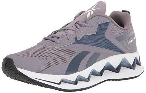 """<p><strong>Reebok</strong></p><p>amazon.com</p><p><strong>$43.31</strong></p><p><a href=""""https://www.amazon.com/dp/B07ZHYNG7B?tag=syn-yahoo-20&ascsubtag=%5Bartid%7C10065.g.36210019%5Bsrc%7Cyahoo-us"""" rel=""""nofollow noopener"""" target=""""_blank"""" data-ylk=""""slk:Shop Now"""" class=""""link rapid-noclick-resp"""">Shop Now</a></p><p>Calling all long-distance runners: Add Reebok's Zig Elusion Energy sneakers to your cart. Not only does this pair have a responsive cushioning to add a little oomph to your runs, but it also has a Zig Energy TPU Plate, which offers support and stability. </p>"""