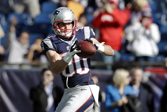 FILE - In this Oct. 27, 2013, file photo, New England Patriots wide receiver Danny Amendola warms up before an NFL football game against the Miami Dolphins in Foxborough, Mass. Amendola joined New England as a free agent from the St. Louis Rams in March and has just 29 catches after missing four games with injuries, but has played the last three games. Amendola and the Patriots will take on the Denver Broncos, Sunday, Nov. 24. (AP Photo/Steven Senne, File)