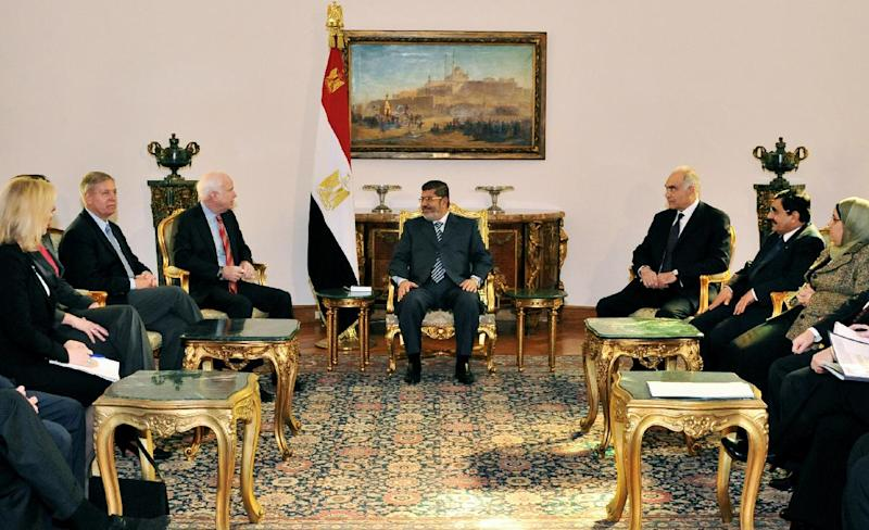 In this image released by the Egyptian Presidency, Egyptian President Mohammed Morsi, center, meets with Republican Sen. John McCain, center left, at the Presidential Palace in Cairo, Egypt, Wednesday, Jan. 16, 2013. Morsi met with McCain in Cairo on Wednesday, for a visit expected to last three days. The meeting comes after the Obama administration on Tuesday gave a blistering review of remarks that the Egyptian President made almost three years ago about Jews and called for him to repudiate what it called unacceptable rhetoric. (AP Photo/Egyptian Presidency)