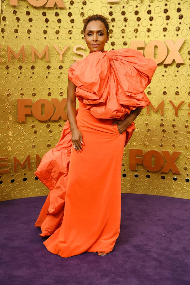 Janet Mock wore an unforgettable neon peach gown with exaggerated ruffle details.