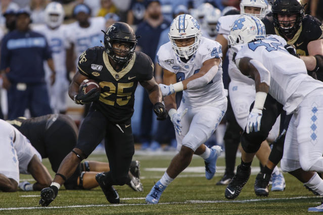 Wake Forest running back Kenneth Walker III carries the football against North Carolina during the first half of an NCAA college football game in Winston-Salem, N.C., Friday, Sept. 13, 2019. (AP Photo/Nell Redmond)