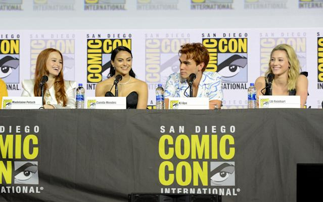 """Madelaine Petsch, Camila Mendes, KJ Apa and Lili Reinhart speak at the """"Riverdale"""" Special Video Presentation and Q&A during 2019 Comic-Con International at San Diego Convention Center on July 21, 2019 in San Diego, California. (Photo by Albert L. Ortega/Getty Images)"""