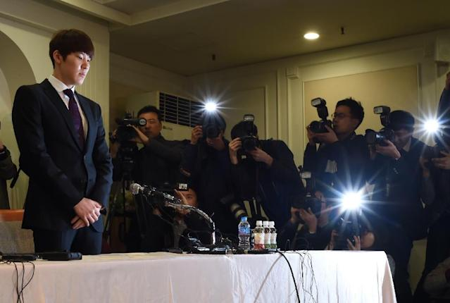 Disgraced South Korean swimmer Park Tae-Hwan makes an emotional public apology over his failed doping test, in Seoul, in March 2015 (AFP Photo/Ed Jones)