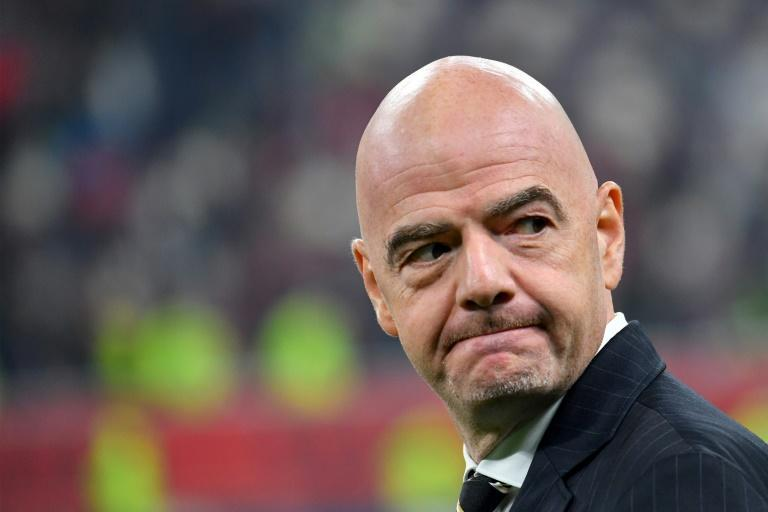 Gianni Infantino will stay on as head of FIFA as the body slammed the opening of a criminal investigation against him in Switzerland (AFP Photo/Giuseppe CACACE)
