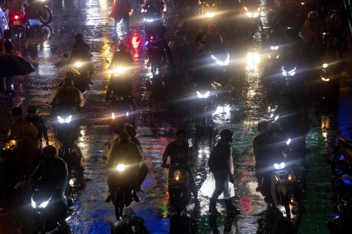 Pro-democracy demonstrators travel on motorcycles after ending their protest for the day in Bangkok, Thailand, Friday, Oct. 16, 2020. Thailand prime minister has rejected calls for his resignation as his government steps up efforts to stop student-led protesters from rallying in the capital for a second day in defiance of a strict state of emergency. (AP Photo/Gemunu Amarasinghe)