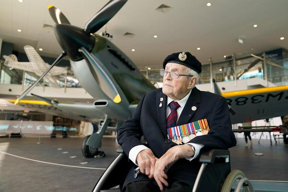 Veteran Norman Lewis, 102, beside the newly restored Spitfire (Jacob King/PA) (PA Wire)