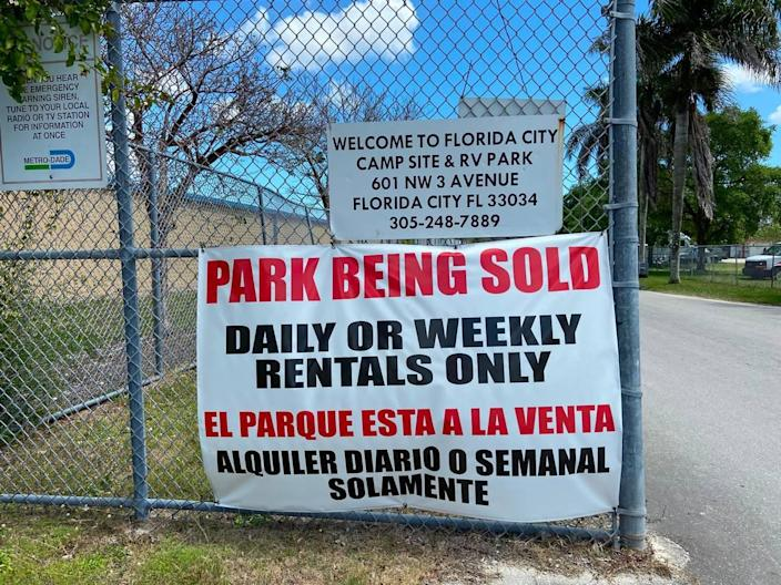 A sign hangs on the entrance to Florida City Camp Site and RV Park that says it has been sold.