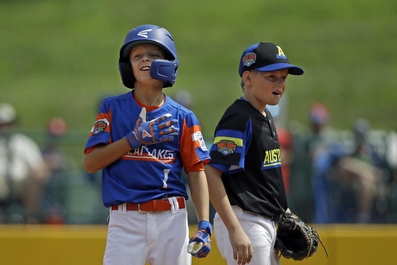 Bowling Green, Kentucky's Jackson Idlett (1) celebrates hitting a double as Australia's Harrison Ford watches during the second inning of a baseball game at the Little League World Series tournament in South Williamsport, Pa., Monday, Aug. 19, 2019. (AP Photo/Tom E. Puskar)