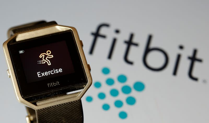 FILE PHOTO: Fitbit Blaze watch is seen in front of a displayed Fitbit logo in this illustration