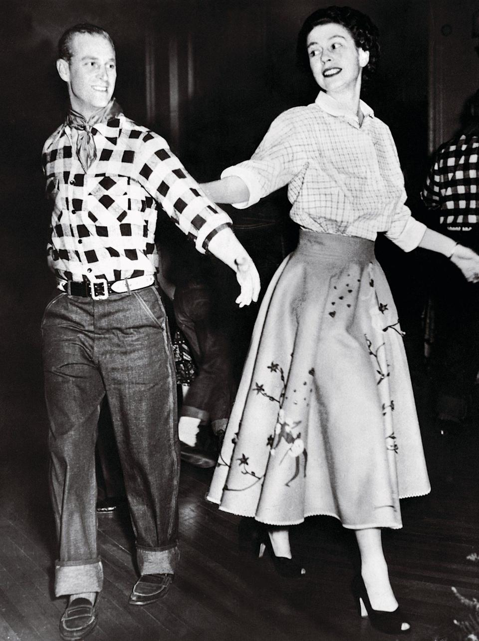 <p>Two years before her coronation, then-Princess Elizabeth grabbed her partner — her husband of four years, naturally — for a spin during a royal tour of Canada in 1951. The pair dressed the part (complete with a neckerchief for Philip!) as they enjoyed an old-fashioned square dance in Ottawa.</p>