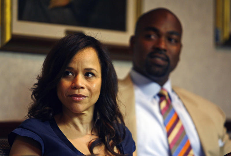 U.S. actress Rosie Perez, left, and former major league baseball player Carlos Delgado look on during a press conference in San Juan, Puerto Rico, Tuesday, May 3, 2011. A celebrity-enhanced ACLU delegation, which included Oscar-nominated Perez and  Delgado, criticized Puerto Rico's government Tuesday for using police to keep the island's main university system open during a strike over a new fee, with members saying they found clear evidence in which officers abused students during the protests. (AP Photo/Ricardo Arduengo)