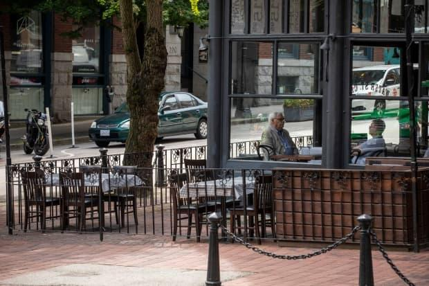 People eat inside a restaurant in Vancouver's Gastown, Salmo Mayor Diana Lockwood wants to see indoor dining restrictions lifted this week as tourist towns hope for a busy summer.