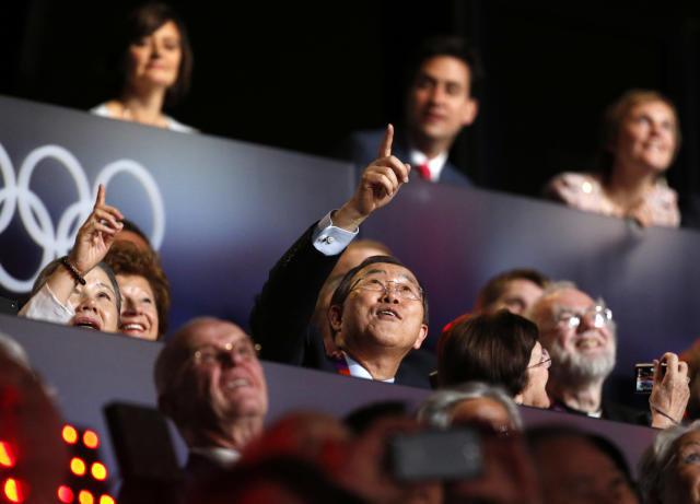 United Nations Secretary General Ban Ki-moon, center, gestures during the Opening Ceremony at the 2012 Summer Olympics, Friday, July 27, 2012, in London. (AP Photo/Jae C. Hong)