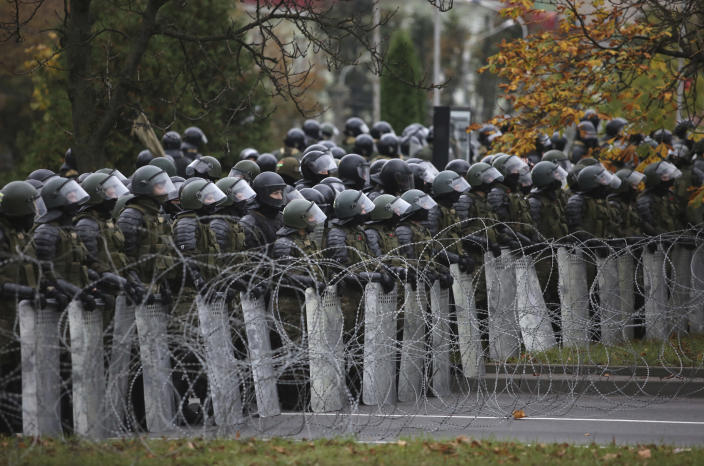 Belarusian police block a street during an opposition rally to protest the official presidential election results in Minsk, Belarus, Sunday, Oct. 25, 2020. The demonstrations were triggered by official results giving President Alexander Lukashenko 80% of the vote in the Aug. 9 election that the opposition insists was rigged. Lukashenko, who has ruled Belarus with an iron fist since 1994, has accused the United States and its allies of fomenting unrest in the ex-Soviet country. (AP Photo)