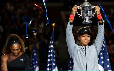 <span>Osaka, tearfully, lifts her first grand slam trophy</span> <span>Credit: Getty Images </span>