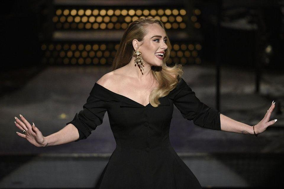"""<p>Adele is very private about her personal life, which makes it unsurprising that she hasn't publicly addressed <a href=""""https://www.prevention.com/weight-loss/a29664529/adele-weight-loss/"""" rel=""""nofollow noopener"""" target=""""_blank"""" data-ylk=""""slk:her weight loss"""" class=""""link rapid-noclick-resp"""">her weight loss</a>, aside from a slight joke about her """"different"""" appearance while hosting <a href=""""https://www.youtube.com/watch?v=LlWs87C2B7Q&feature=emb_title"""" rel=""""nofollow noopener"""" target=""""_blank"""" data-ylk=""""slk:Saturday Night Live"""" class=""""link rapid-noclick-resp""""><em>Saturday Night Live</em></a> in October 2020. According to <em><a href=""""https://www.usmagazine.com/celebrity-body/news/adele-weight-loss-post-divorce-trainer-cardio-pilates/"""" rel=""""nofollow noopener"""" target=""""_blank"""" data-ylk=""""slk:Us Weekly"""" class=""""link rapid-noclick-resp"""">Us Weekly</a></em>, the British singer hired a personal trainer and has been doing 60-minute workouts that involve cardio, circuit training, and Pilates. The star is reportedly following the <a href=""""https://www.prevention.com/weight-loss/diets/a29666720/sirtfood-diet/"""" rel=""""nofollow noopener"""" target=""""_blank"""" data-ylk=""""slk:Sirtfood diet"""" class=""""link rapid-noclick-resp"""">Sirtfood diet</a> as well. """"She really wants to be healthy and set a good example for her son,"""" a source close to Adele told <em>Us.</em></p>"""