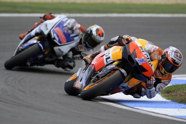 Repsol Honda team's Australian Casey Stoner rides ahead Yamaha Factory Racing team's Spanish Jorge Lorenzo during the Moto GP race of the Portuguese Grand Prix in Estoril, outskirts of Lisbon, on May 6, 2012. Stoner won the race ahead of Lorenzo and Pedrosa. AFP PHOTO / MIGUEL RIOPAMIGUEL RIOPA/AFP/GettyImages