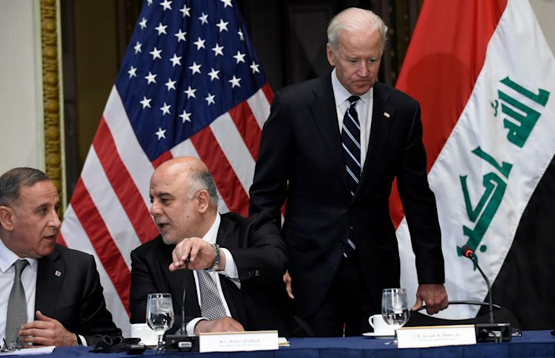 Biden arriving at an event with then-Iraqi Prime Minister Haider al-Abadi (second from left), whom the U.S. scrambled to help form a government after Maliki's controversial reign. (Photo: ASSOCIATED PRESS)