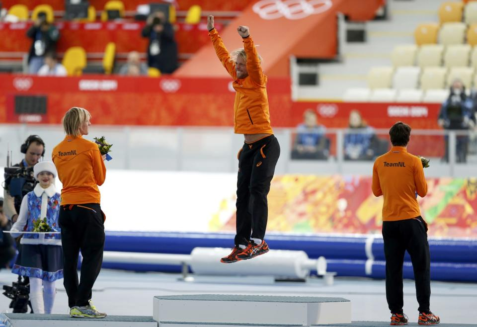 Winner of the men's 500 meters speed skating competition Michel Mulder of the Netherlands celebrates at the flower ceremony for the event at the 2014 Sochi Winter Olympics, February 10, 2014. REUTERS/Issei Kato (RUSSIA - Tags: OLYMPICS SPORT SPEED SKATING)