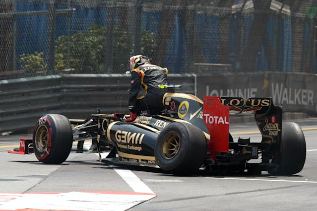 Lotus F1 Team's French driver Romain Grosjean gets out of his car after crashing at the Circuit de Monaco on May 27, 2012 in Monte Carlo during the Monaco Formula One Grand Prix. AFP PHOTO / TOM GANDOLFINITom Gandolfini/AFP/GettyImages