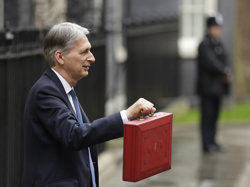 Chancellor Philip Hammond holds the red dispatch box on budget day: AP