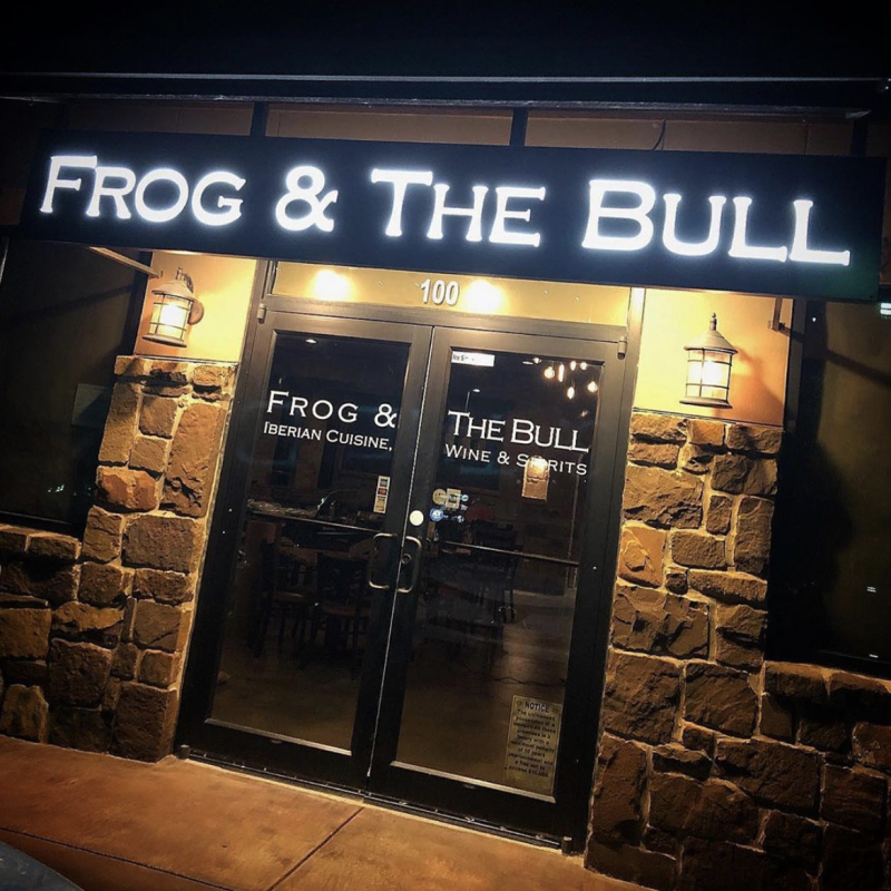 The entrance of the Frog & The Bull restaurant.
